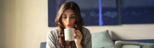 Brunette woman drinking a cup of coffee
